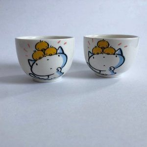 Two cute kitty and ducky bowls